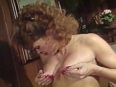 Two older women share a huge cock