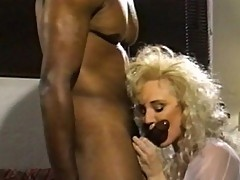 Mature blonde bitch sucks black meat